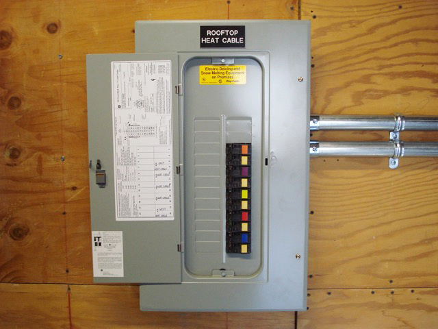 Remote electrical panel for controlling commercial rooftop heat tape operation