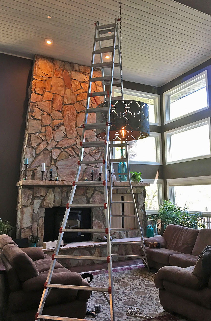 Mounting a ceiling light fixture in a lving room in a custom home in Flagstaff